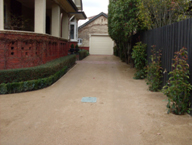 Underground rainwater tank covered by driveway in Melbourne